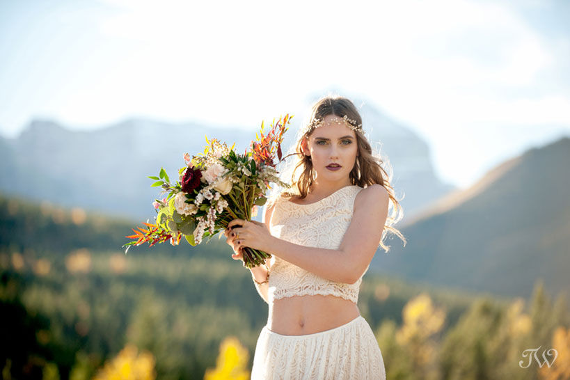 bohemian bride carries her fall bouquet from Flowers by Janie captured by Tara Whittaker Photography