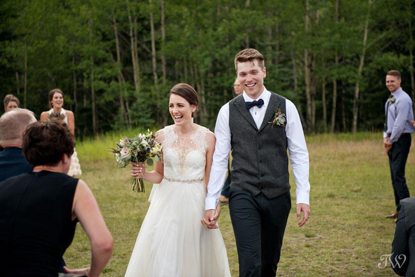 just married at Rundleview Parkette in Canmore captured by Calgary wedding photographer Tara Whittaker
