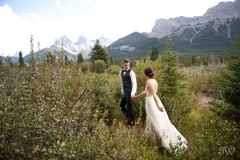 bride and groom near The Three Sisters in Canmore Tara Whittaker Photography