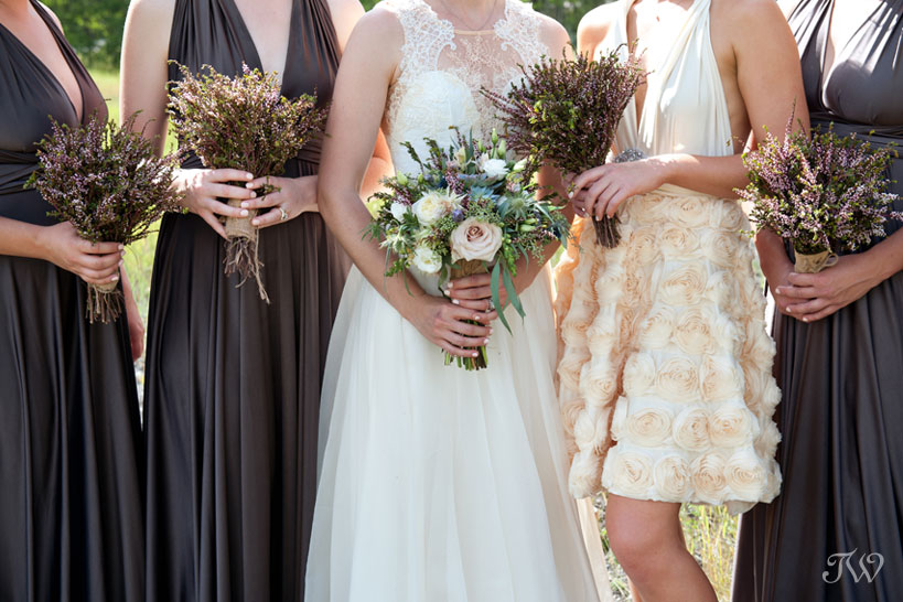 bridesmaids carrying bouquets from Black Earth Floral captured by Calgary wedding photographer Tara Whittaker