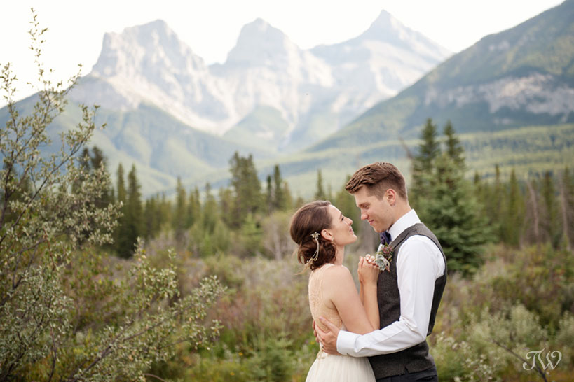 couple in front of The Three Sisters before their Cornerstone Theatre wedding
