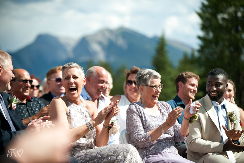 moment of laughter during ceremony captured by Calgary wedding photographer Tara Whittaker
