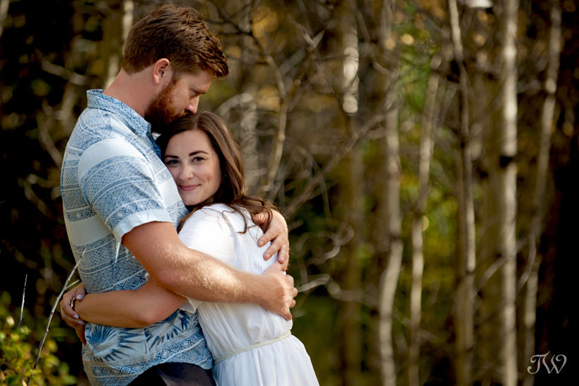 couple embrace during their fall engagement session captured by Tara Whittaker Photography