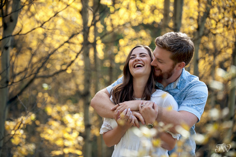 love and laughs during a fall engagement session in Kananaskis