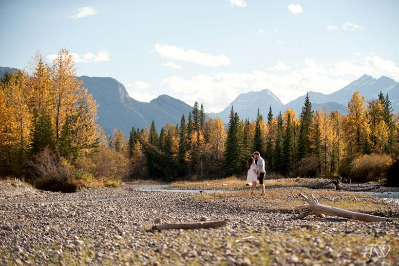 couple beside the Kananaskis River captured by Calgary wedding photographer Tara Whittaker