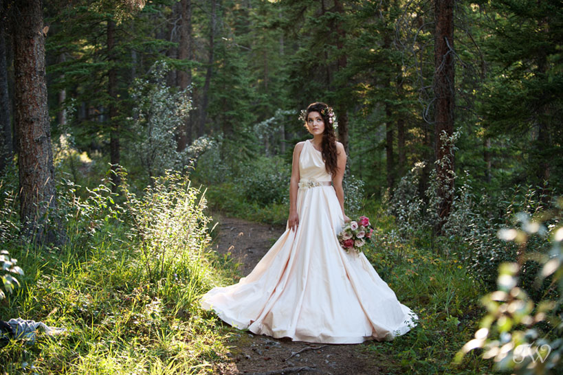 Rocky Mountain bride in the woods captured by Calgary wedding photographer Tara Whittaker