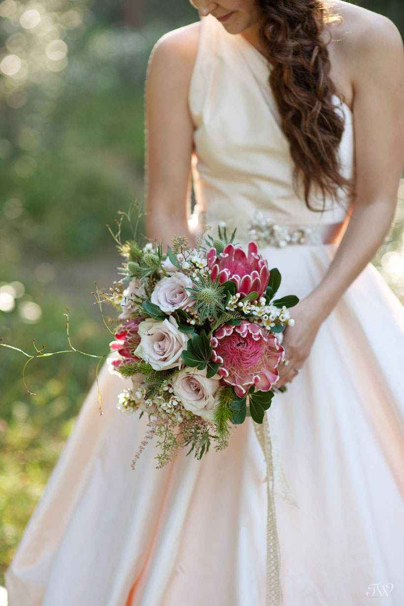 Rocky Mountain bride carries a bouquet of Protea from Flowers by Janie