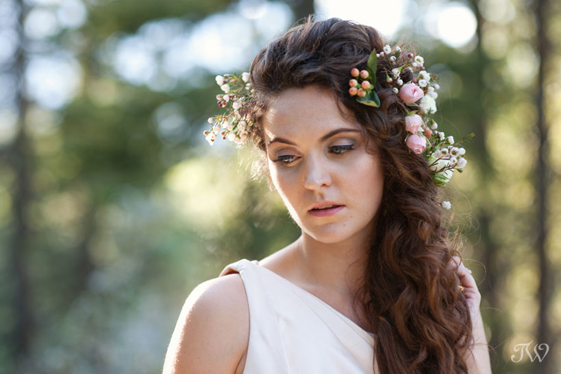 Rocky Mountain bride with flowers in her hair captured by Calgary wedding photographer Tara Whittaker
