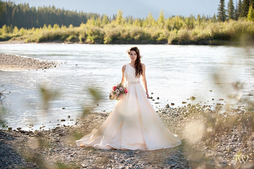 Rocky Mountain bride wearing Romona Keveza captured by Calgary wedding photographer Tara Whittaker