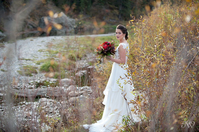 Bride in Fish Creek Park wearing Hayley Paige bridal captured by Calgary wedding photographer Tara Whittaker