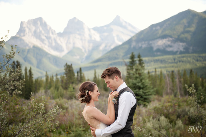 bride and groom in front of the Three Sisters in Canmore