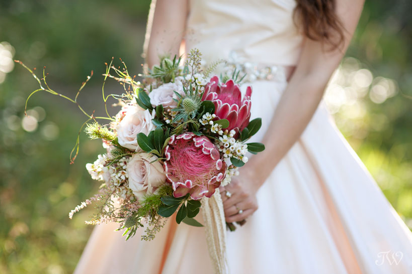 Mountain bride carries protea 2016 bridal bouquet captured by Tara Whittaker Photography