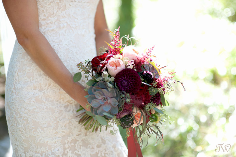 mountain bride carries bouquet by Willow Flower Co at her Quarry Lake wedding