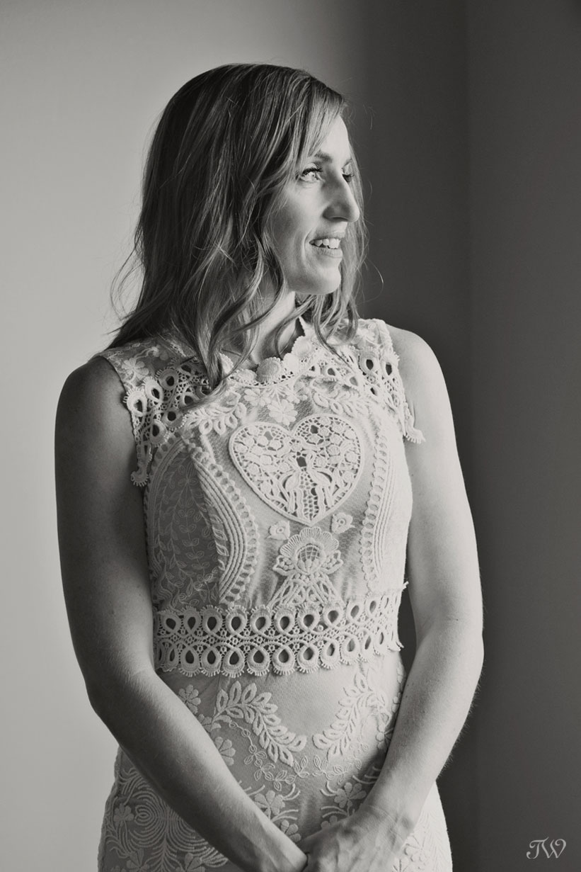 Bride wearing a lace BHLDN gown captured by Calgary wedding photographer Tara Whittaker