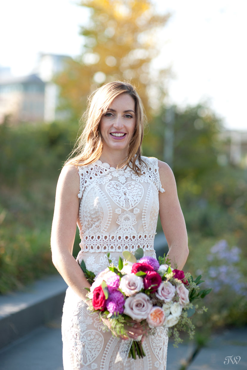 bride carrying bouquet from Flowers by Janie captured by Tara Whittaker Photography