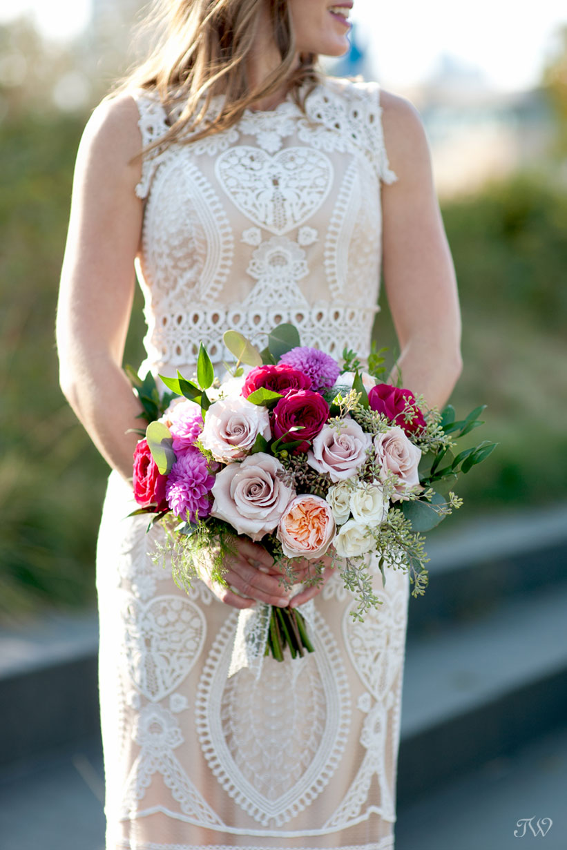 bride carries a bouquet from Flowers by Janie captured by Tara Whittaker Photography