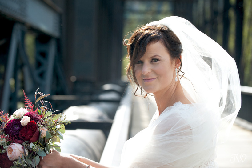 bride on the railway bridge in Canmore captured by Tara Whittaker Photography