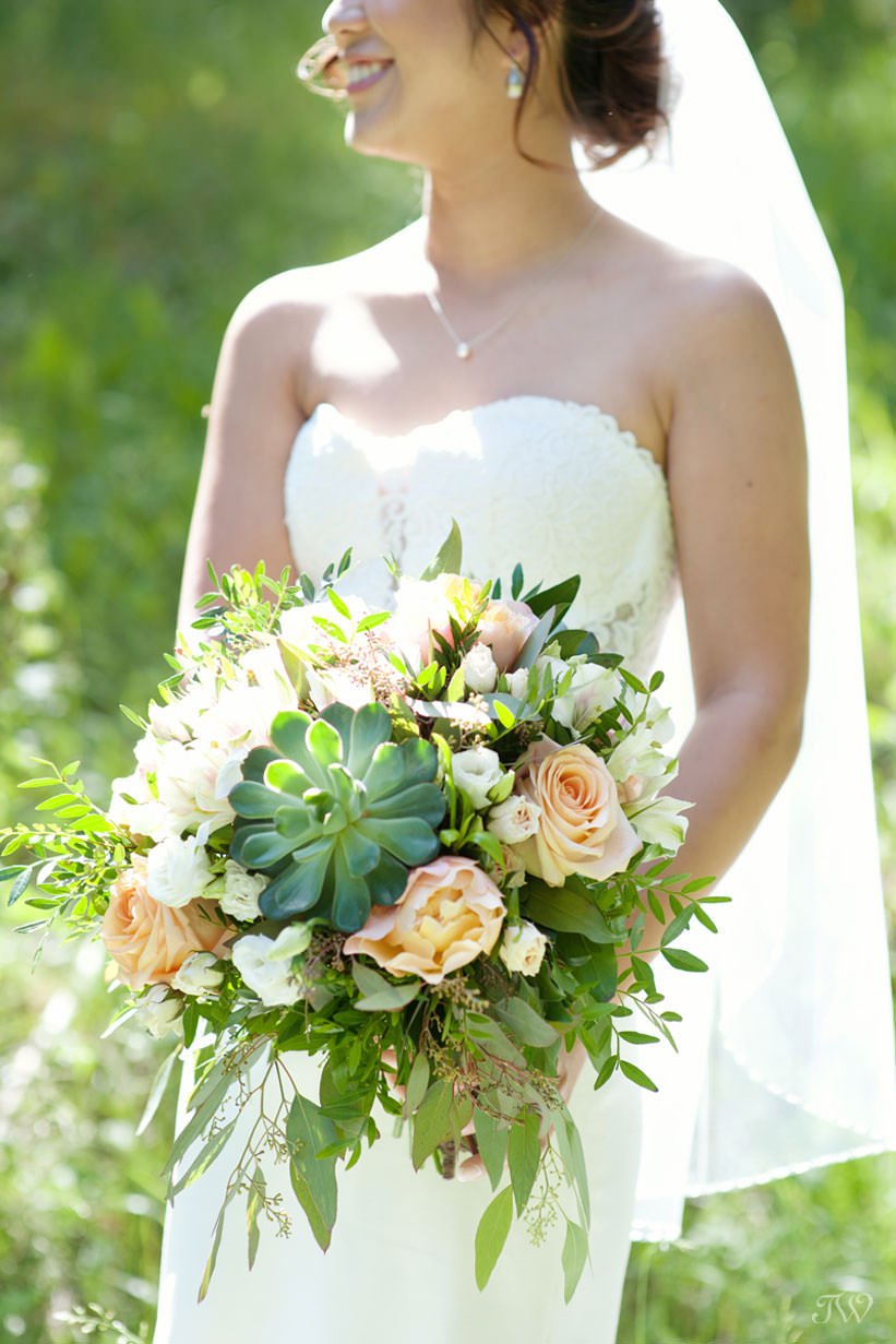 Banff bride with her bouquet from Elements captured by Tara Whittaker Photography