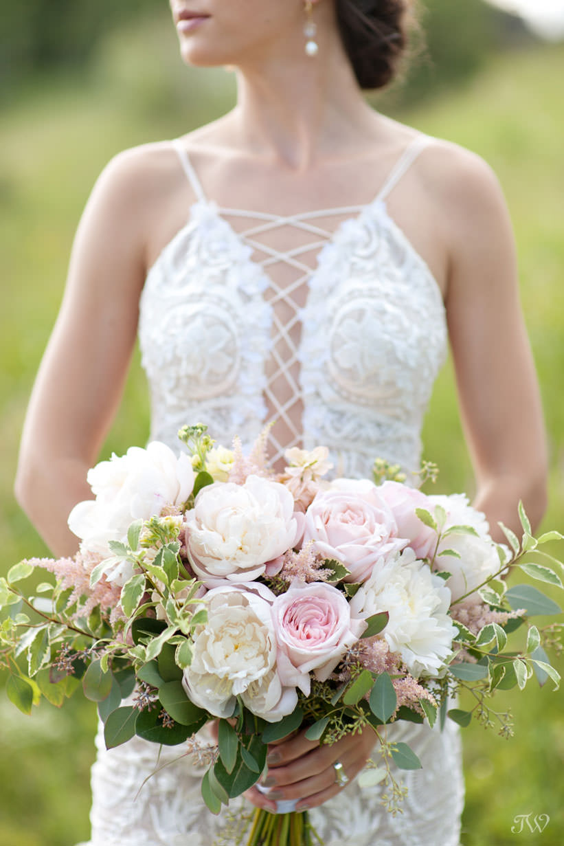 summer bride with a bouquet of peonies from Fleurish Flower Shop captured by Tara Whittaker Photography