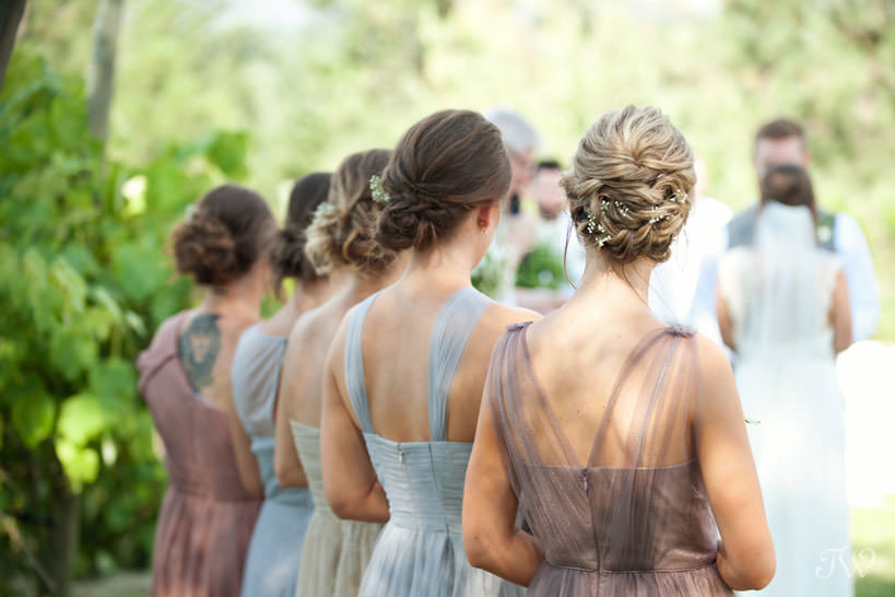 bridesmaids during vineyard wedding ceremony in Kelowna captured by Tara Whittaker Photography