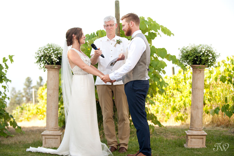 vows during vineyard wedding ceremony in Kelowna captured by Tara Whittaker Photography