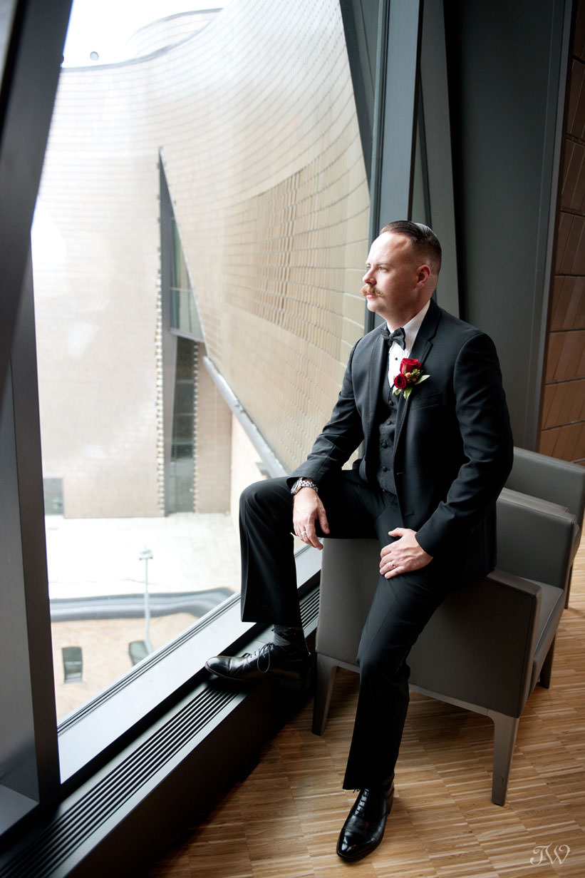 groom at the National Music Centre captured by Calgary wedding photographer Tara Whittaker