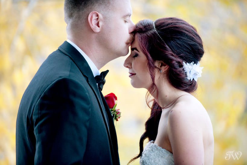wedding portraits on Lake Bonavista captured by Calgary wedding photographer Tara Whittaker