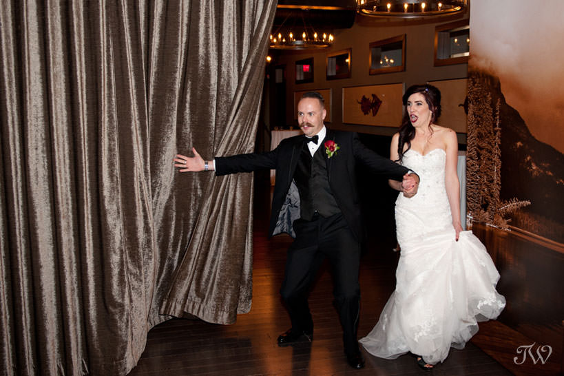 grand entrance of the bride and groom at Lake House wedding captured by Tara Whittaker Photography