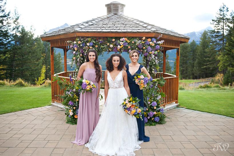 bridal party at the Silvertip wedding gazebo captured by Calgary wedding photographer Tara Whittaker