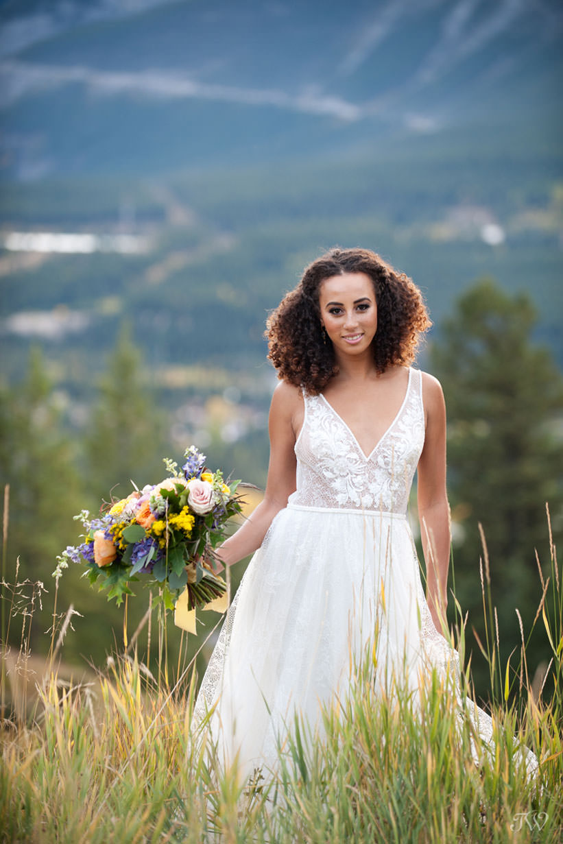 bride on a mountainside Silvertip wedding captured by Calgary wedding photographer Tara Whittaker