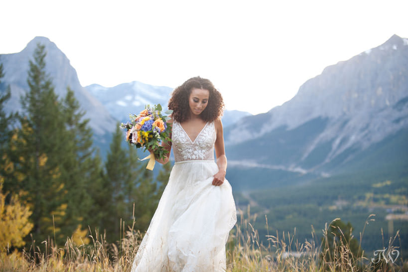 bride in the mountains at her Silvertip wedding captured by Calgary wedding photographer Tara Whittaker