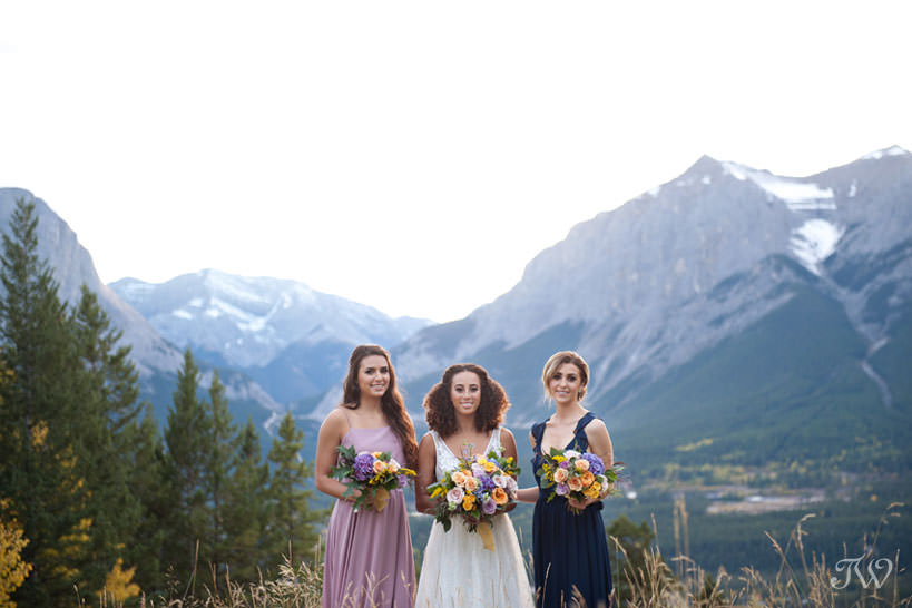 bridal party in the Rockies at a Silvertip wedding captured by Calgary wedding photographer Tara Whittaker