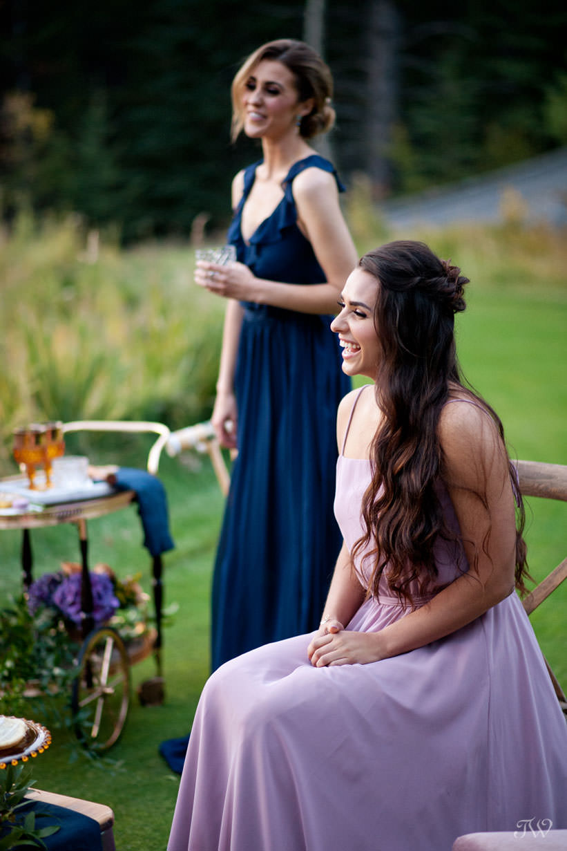 bridesmaids enjoy cocktails at a Silvertip wedding captured by Calgary wedding photographer Tara Whittaker