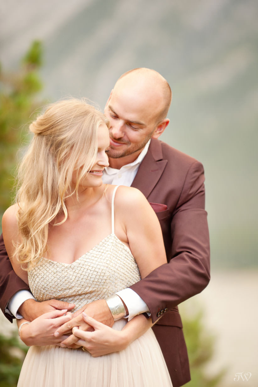 Bride and groom embrace at their Spray Lakes engagement session captured by Tara Whittaker Photography