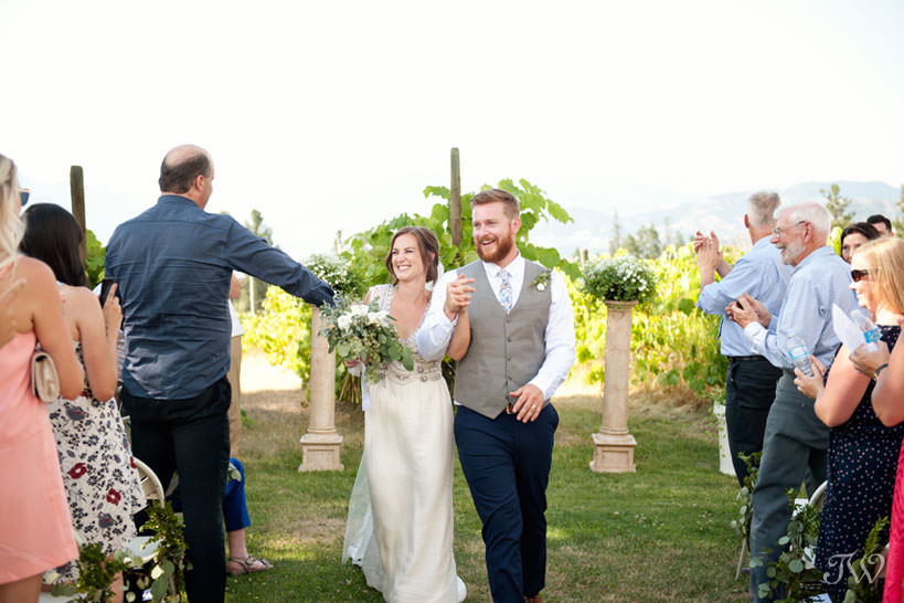 newlyweds during vineyard wedding ceremony in Kelowna captured by Tara Whittaker Photography