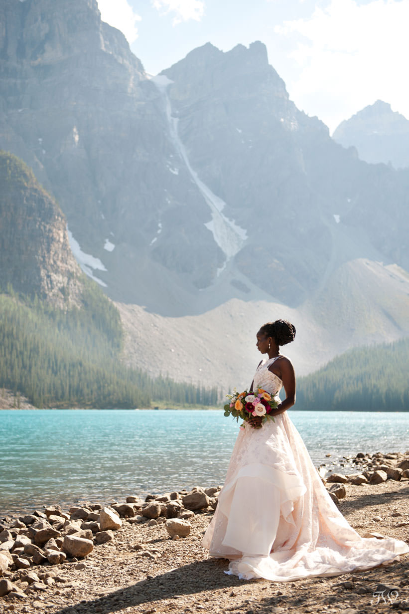 Moraine Lake bride Debol on the lakeshore captured by Tara Whittaker Photography