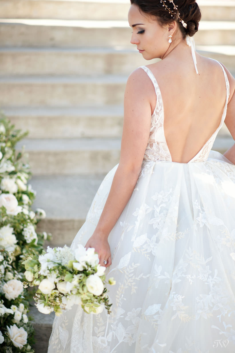 Bride in Lazaro gown at Spruce Meadows captured by Calgary wedding photographer Tara Whittaker