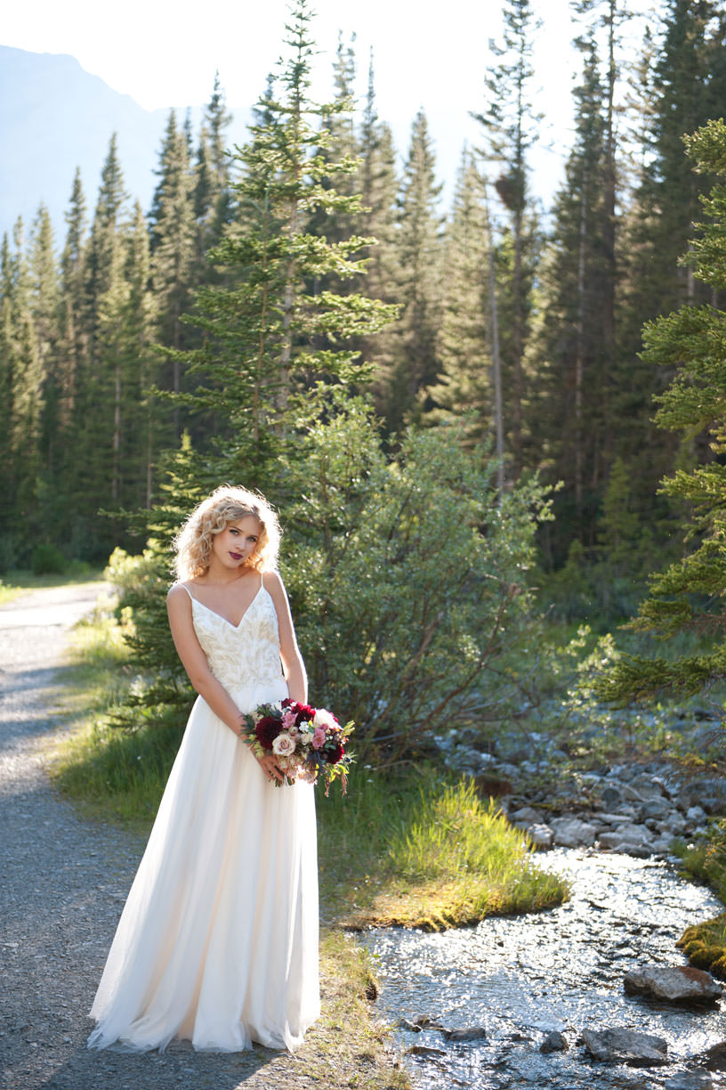 Bride poses for Canmore wedding photos with Tara Whittaker Photography