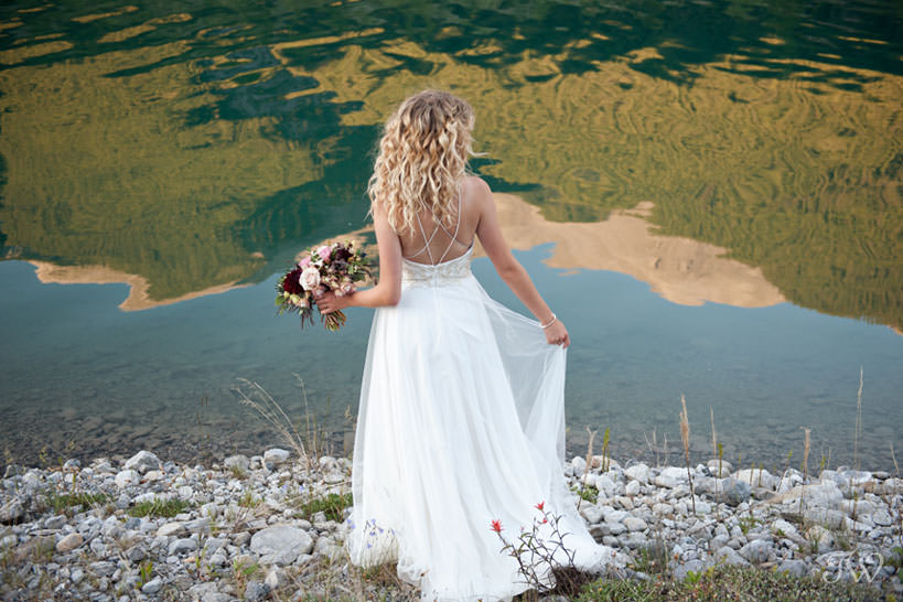 Bride during Canmore wedding photos at Spray Lakes Canals captured by Tara Whittaker Photography