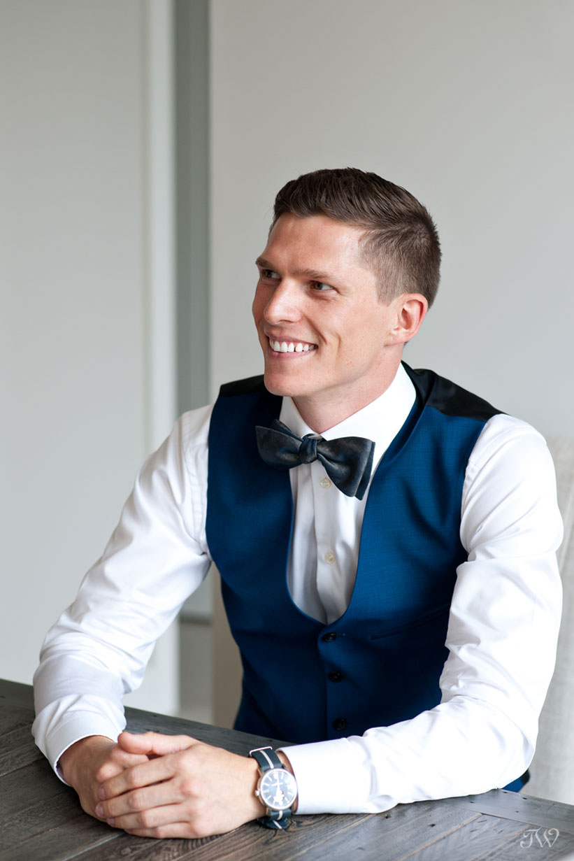 Groom in a bowtie captured by Calgary wedding photographer Tara Whittaker