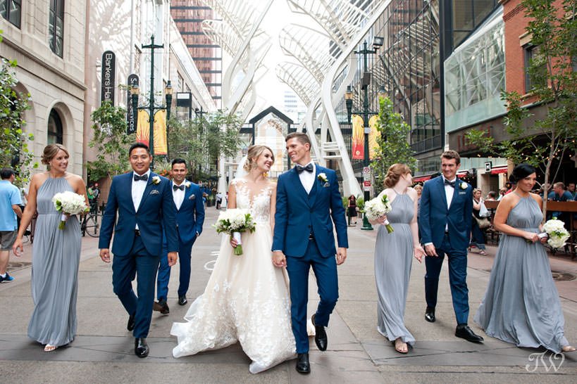 bridal party on Stephen Avenue captured by Calgary wedding photographer Tara Whittaker