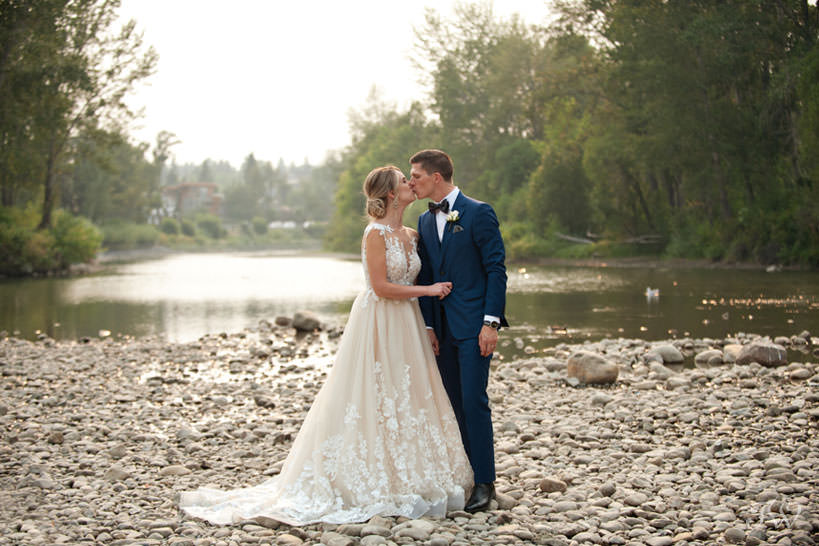 bride and groom at Stanley Park in Calgary captured by Calgary wedding photographer Tara Whittaker