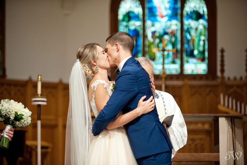 first kiss at St Stephen's captured by Church Calgary wedding photographer Tara Whittaker