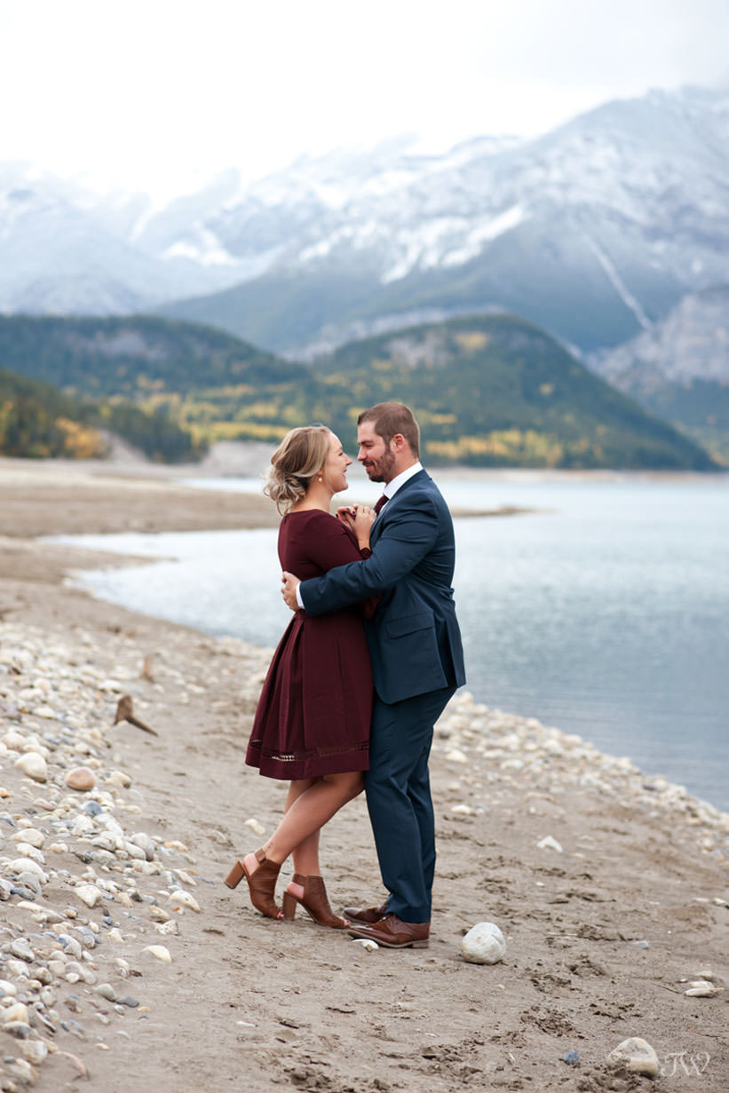 bride and groom on the shore of Barrier Lake in Kananaskis captured by Tara Whittaker Photography